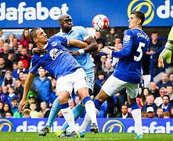 Eliaquim Mangala of Manchester City fouls Everton's Phil Jagielka  - Mandatory byline: Matt McNulty/JMP - 07966386802 - 23/08/2015 - FOOTBALL - Goodison Park -Everton,England - Everton v Manchester City - Barclays Premier League