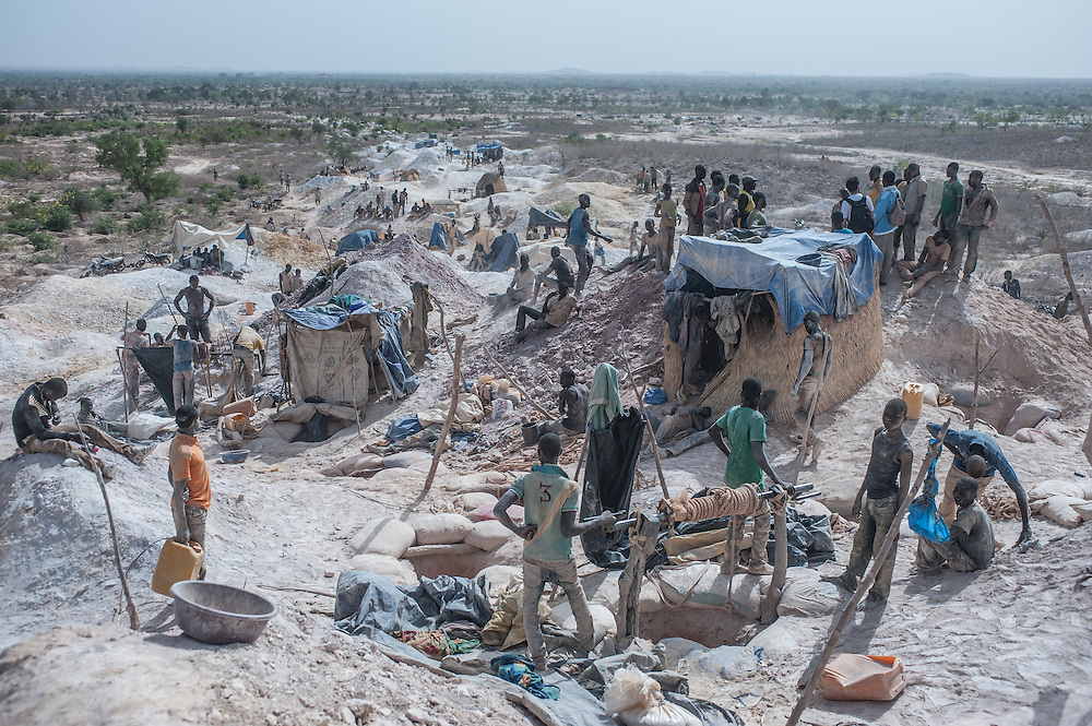 Nobsin, Burkina Faso - 13 May 2014: a general view of the gold mining site. The Burkinabe authorities estimate that in 2013, one ton of gold was extracted in the illegal mines while the industrial gold production, rose from 23 tonnes in 2010 to 32 tonnes in 2011, making the country the 4th largest gold producer in Africa.