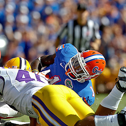 October 8, 2011; Baton Rouge, LA, USA;  LSU Tigers linebacker Kevin Minter (46) forces a fumble by Florida Gators running back Chris Rainey (1) during the first quarter at Tiger Stadium.  Mandatory Credit: Derick E. Hingle-US PRESSWIRE / © Derick E. Hingle 2011