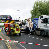 RTC on Tay Street, Perth.....19.07.10<br /> Recovery crews clear the remains of a lorry pictured on Tay Street in Perth after it collided with the railway bridge on the Perth to Dundee line ripping the roof of the lorry off and shedding its load. The road was closed as structural engineers checked the bridge.<br /> Picture by Graeme Hart.<br /> Copyright Perthshire Picture Agency<br /> Tel: 01738 623350  Mobile: 07990 594431