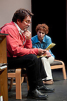 "Jim Rogato as Nick/Fireman reads through notes written by Katie Dunn as Joan/the Editor as they work together in writing eulogies for the fallen firefighters of 9/11 during the dress rehearsal of ""The Guys"" at the Winnipesaukee Playhouse on Wednesday evening.  (Karen Bobotas/for the Laconia Daily Sun)"