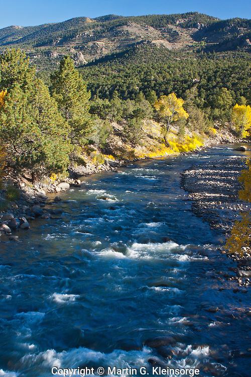 The Arkansas River flowing through the Upper Arkansas Valley during the autumn season.  Colorado.
