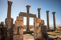 Columns and archeways from the ruins of Roman theaters, bath houses, mausoleums, and terraces of the ancient Decapolis city of Gadara.