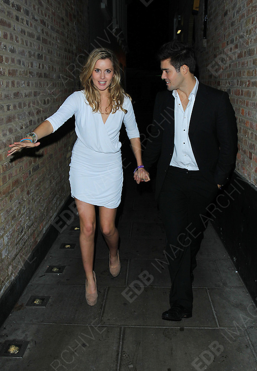 07.NOVEMBER.2011. LONDON<br /> <br /> CAGGIE DUNLOP AND SPENCER MATTHEWS LEAVING AN ALLEYWAY WHERE THEY SEEN KISSING AND CUDDLING. THEY PAIR WERE IN MAHIKI EARLIER THAT NIGHT IN LONDON<br /> <br /> BYLINE: EDBIMAGEARCHIVE.COM<br /> <br /> *THIS IMAGE IS STRICTLY FOR UK NEWSPAPERS AND MAGAZINES ONLY*<br /> *FOR WORLD WIDE SALES AND WEB USE PLEASE CONTACT EDBIMAGEARCHIVE - 0208 954 5968*