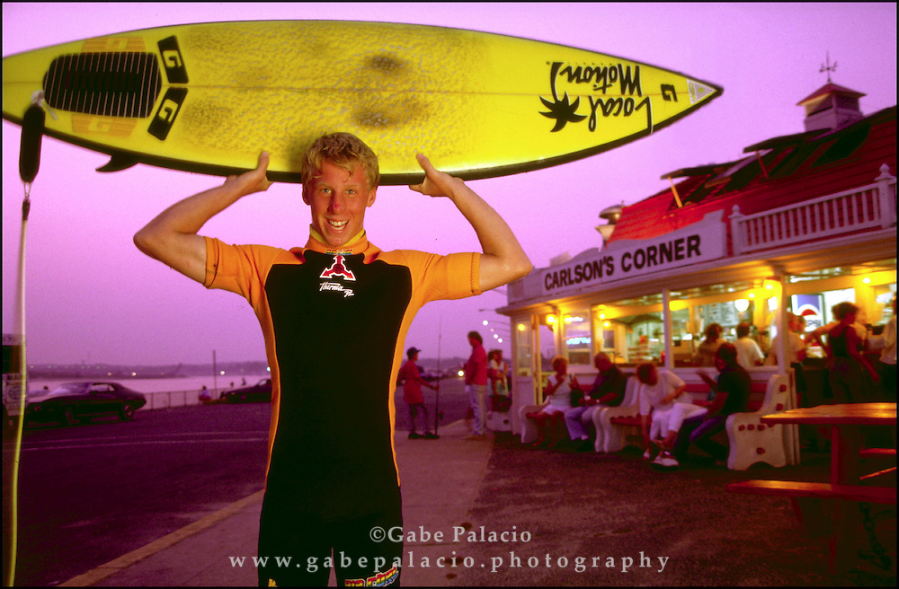 Surfer by a beachside snack bar in Manasquan, New Jersey.