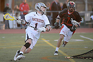 DOYLESTOWN, PA - APRIL 16:  Central Bucks East's Matthew Brown #1 charges around the net as Hatboro Horsham's #7 (NOT ON ROSTER PROVIDED) defends in the first period at War Memorial Field April 16, 2014 in Doylestown, Pennsylvania. (Photo by William Thomas Cain/Cain Images)
