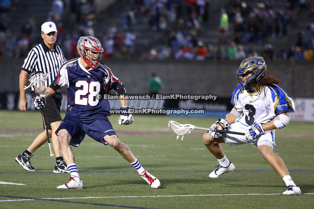 Brent Adams #28 of the Boston Cannons keeps the ball away from Josh Hawkins #3 of the Charlotte Hounds during the game at Harvard Stadium on May 17, 2014 in Boston, Massachuttes. (Photo by Elan Kawesch)