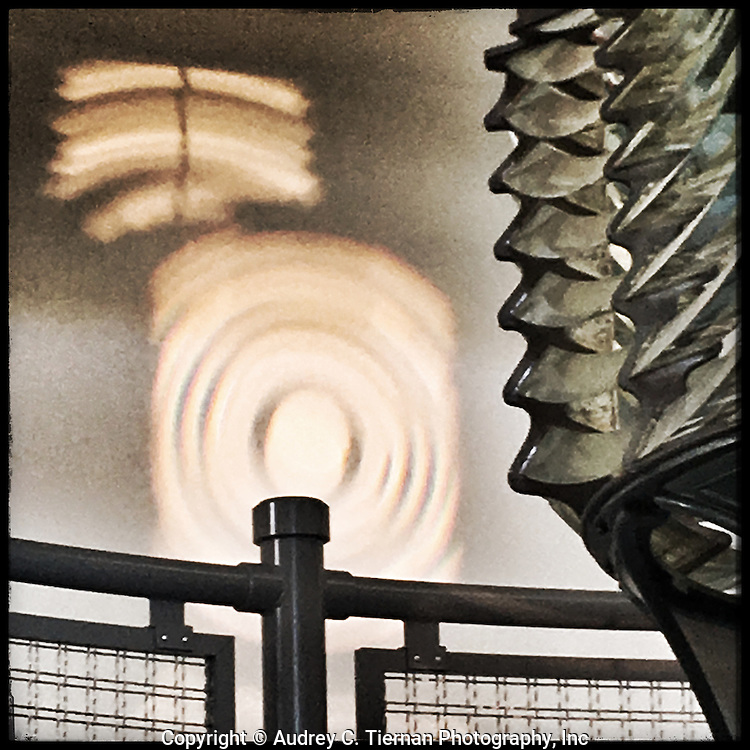 Babylon, NY,  October 25, 2016: ---Shadows cast by the original ten foot first order fresnel lens inside the lens building at the Fire Island Lighthouse.                                              © Audrey C. Tiernan