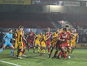 Paul Clayton of Alfreton Town flicks on into a packed penalty area during the The FA Cup match between Newport County and Alfreton Town at Rodney Parade, Newport, Wales on 15 November 2016. Photo by Andrew Lewis.