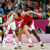 07 August 2012: USA Tina Charles defends on Canada Krista Phillips as she reaches for the ball during 91-48 Team USA victory over Team Canada, during the women's basketball quarter-finals, at the Basketball Arena, in London, Great Britain.