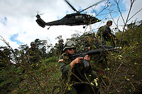 Members of the Jungla, a unit of the Colombian anti-narcotics police, disembark from a Blackhawk helicopter into a coca field during a mission to destroy coca labs in the Colombian state of Bolivar, on July 3, 2007. (Photo/Scott Dalton)