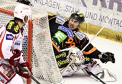26.02.2013, Eisstadion Liebenau, Graz, AUT, EBEL, Graz 99ers vs EC KAC, Playoff best of seven, 2. Runde, im Bild Guillaume Lefebvre (99ers, #14) und Andy Chiodo (EC KAC, #31) // during the Erste Bank Icehockey League playoff best of seven 1st round match between Graz 99ers and EC KAC at the Icehockey Stadium Liebenau, Graz, Austria on 2013/02/26. EXPA Pictures © 2013, PhotoCredit: EXPA/ Patrick Leuk