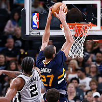 02 April 2017: Utah Jazz center Rudy Gobert (27) goes for the dunk past San Antonio Spurs forward Kawhi Leonard (2) during the San Antonio Spurs 109-103 victory over the Utah Jazz, at the AT&T Center, San Antonio, Texas, USA.