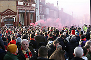 Liverpool fans await the arrival of the team bus for the Premier League match between Liverpool and Manchester United at Anfield, Liverpool, England on 19 January 2020.