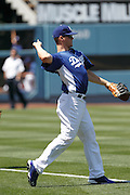 LOS ANGELES - MAY 30:  First baseman Jerry Sands #47 of the Los Angeles Dodgers plays catch during batting practice at the game between the Colorado Rockies and the Los Angeles Dodgers on Monday, May 30, 2011 at Dodger Stadium in Los Angeles, California. The Dodgers won the game 7-1. (Photo by Paul Spinelli/MLB Photos via Getty Images) *** Local Caption *** Jerry Sands