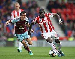 Papa Alioune Ndiaye of Stoke City (R) and Jack Cork of Burnley in action - Mandatory by-line: Jack Phillips/JMP - 22/04/2018 - FOOTBALL - Bet365 Stadium - Stoke-on-Trent, England - Stoke City v Burnley - English Premier League