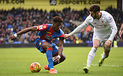 Wilfried Zaha proctects the ball from Adam Lallana during the Barclays Premier League match between Crystal Palace and Liverpool at Selhurst Park, London, England on 6 March 2016. Photo by Michael Hulf.