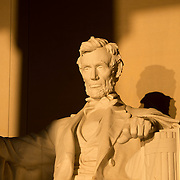 WASHINGTON, DC--Around the time of the spring and fall equinox, with the sun rising directly in th east during that time, the rising sun shines in directly on the statue of Abraham Lincoln inside the Lincoln Memorial. Standing on the western end of the National Mall in Washington DC and next to the Reflecting Pool looking towards the US Capitol Building, the Lincoln Memorial was dedicated in 1922 and is one of Washington DC's most famous landmarks. The large marble statue of Abraham Lincoln that sits inside was designed by Daniel Chester French and carved by the Piccirilli Brothers.