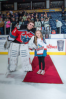 KELOWNA, CANADA - MARCH 18: Jackson Whistle #1 of Kelowna Rockets accepts a star of the game against the Seattle Thunderbirds on March 18, 2015 at Prospera Place in Kelowna, British Columbia, Canada.  (Photo by Marissa Baecker/Shoot the Breeze)  *** Local Caption *** Jackson Whistle;