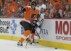 June 9, 2010; Philiadelphia, PA; USA;  Philadelphia Flyers defenseman Chris Pronger (20) hits Chicago Blackhawks center Jonathan Toews (19) during the second period of Game 6 of the Stanley Cup Finals at the Wachovia Center.