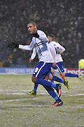 Bury Forward, Leon Clarke peels away after scoring BVurys second and urges the fans to get behind the team during the Sky Bet League 1 match between Bury and Walsall at Gigg Lane, Bury, England on 16 January 2016. Photo by Mark Pollitt.