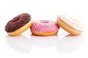Three different donuts on white background.