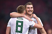 Sam Vokes, right, of Wales national football team celebrates with his teammate Andy King after scoring against Chinese national men's football team in the semi-final match during the 2018 Gree China Cup International Football Championship in Nanning city, south China's Guangxi Zhuang Autonomous Region, 22 March 2018.