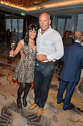 MICHELLE DERS and BRIAN JOKAT at a party to celebrate Jack Petchey's 90th birthday in association with the Stroke Association held at the Shangri-La Hotel, Level 34, The Shard, London on 13th July 2015.