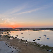 Sunrise aerial seascape, in Ria Formosa wetlands natural park, shot at 60m altitude over Cavacos beach. Algarve. Portugal