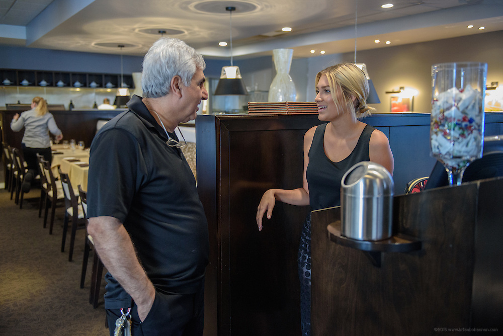 Chef/Owner Anoosh Shariat checks in with Kathryn Peters, hostess at anoosh Bistro, before they open for lunch Monday, Aug. 15, 2016. (Photo by Brian Bohannon)