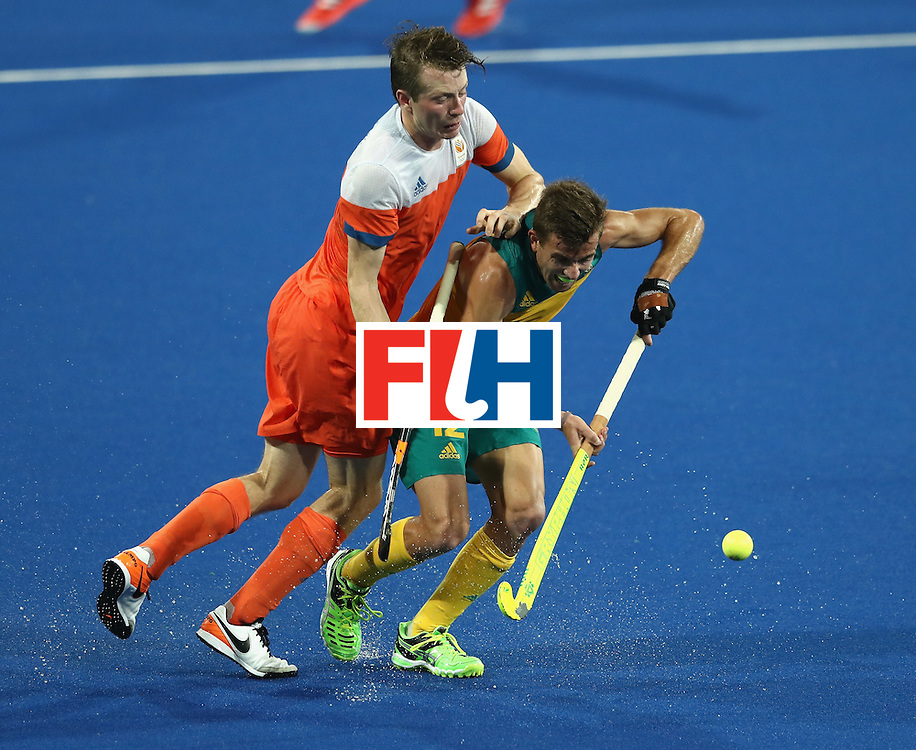 RIO DE JANEIRO, BRAZIL - AUGUST 14:  Jacob Whetton of Australia is challenged by Seve van Ass  during the Men's hockey quarter final match between the Netherlands and Australia on Day 9 of the Rio 2016 Olympic Games at the Olympic Hockey Centre on August 14, 2016 in Rio de Janeiro, Brazil.  (Photo by David Rogers/Getty Images)