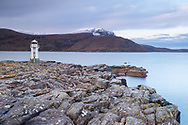 The lighthouse at Rhue, north of Ullapool in northwest Scotland. Set at the head of Loch Broom it enables seafarers to navigate into port. It is unmanned, and not actually that large, maybe 25 feet tall. The setting is spectacular though.
