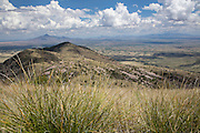View into Mexico from the grassy hillside of Coronado Peak, Coronado National Memorial