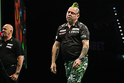 Peter Wright reacts to missing a dart at a double during the PDC Premier League Darts at Arena Birmingham, Birmingham, United Kingdom on 25 April 2019.