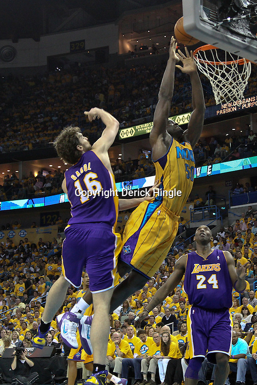 April 22, 2011; New Orleans, LA, USA; New Orleans Hornets center Emeka Okafor (50) is fouled by Los Angeles Lakers power forward Pau Gasol (16) on an attempted dunk during the second quarter in game three of the first round of the 2011 NBA playoffs at the New Orleans Arena.    Mandatory Credit: Derick E. Hingle