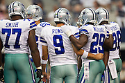 DALLAS, TX - SEPTEMBER 23:  Tony Romo #9 and DeMarco Murray #29 of the Dallas Cowboys in the huddle during a game against the Tampa Bay Buccaneers at Cowboys Stadium on September 23, 2012 in Dallas, Texas.  The Cowboys defeated the Buccaneers 16-10.  (Photo by Wesley Hitt/Getty Images) *** Local Caption *** Tony Romo; DeMarco Murray