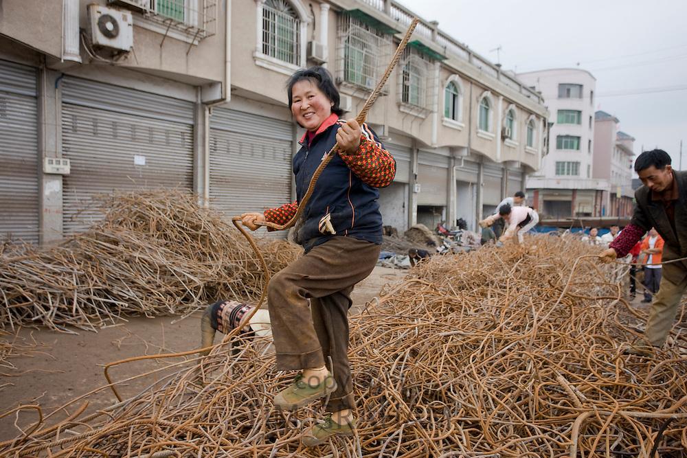 Woman working at metal recycling steel in Dazu County, Chongqing, China