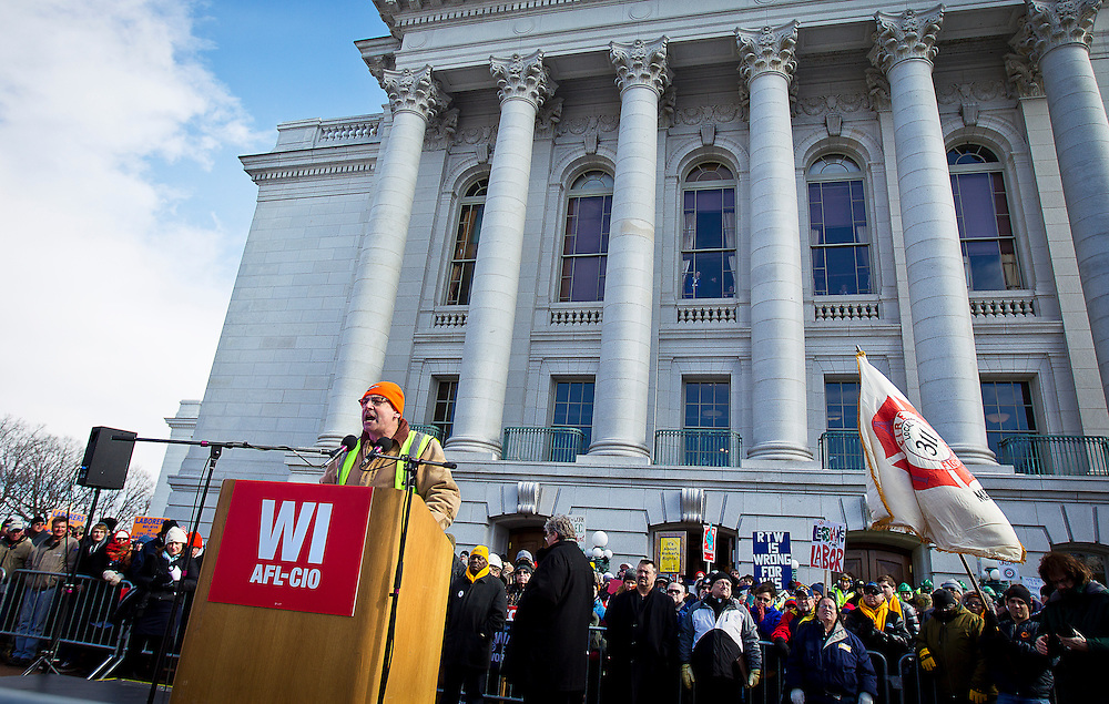 MADISON, WI — FEBRUARY 24: Darren Olsen with Milwaukee Laborers 140 speaks at the podium outside the Wisconsin State Capitol as workers and labor unions protested a right-to-work bill going through the state legislature.