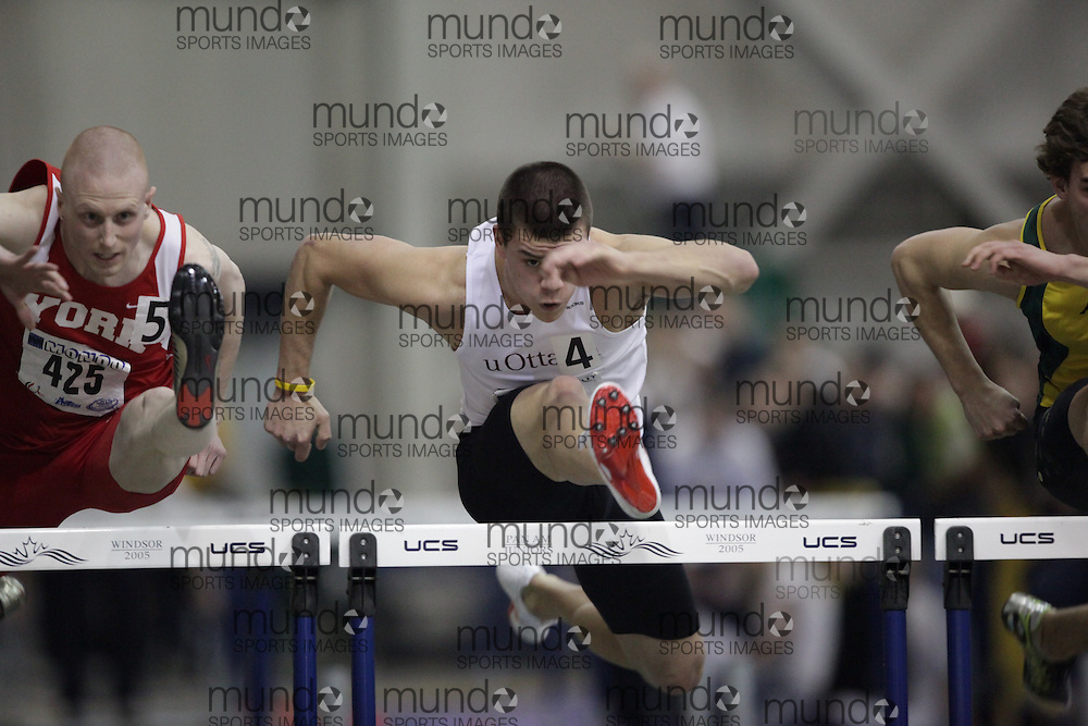 Windsor, Ontario ---13/03/09--- Tyler Fawcett of  the University of Ottawa competes in the 60 meter hurdle prelims at the CIS track and field championships in Windsor, Ontario, March 13, 2009..GEOFF ROBINS Mundo Sport Images