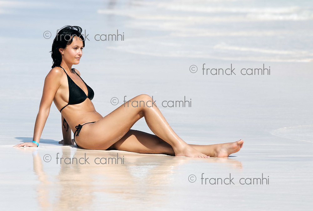 women on the beach of playa del carmen yucatan mexico