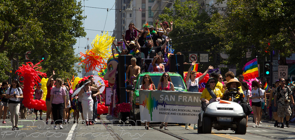 Participants in the 43rd annual San Francisco Pride parade march along Market Street, Sunday, June 30, 2013 in San Francisco. (Photo by D. Ross Cameron)