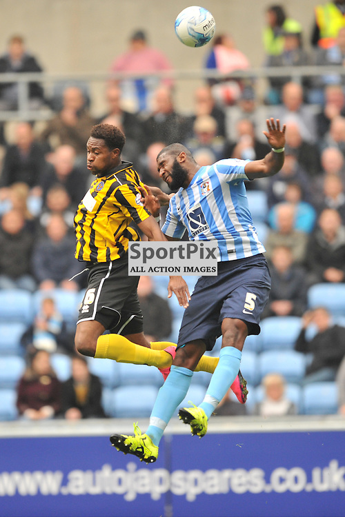 Coventrys Reda Johnson HOLDS OF Shrewsburys John Louis Akpa-Akpro, Coventry City v Shreswsbury Ricoh Arena, Football League One, Saturday 3rd October 2015