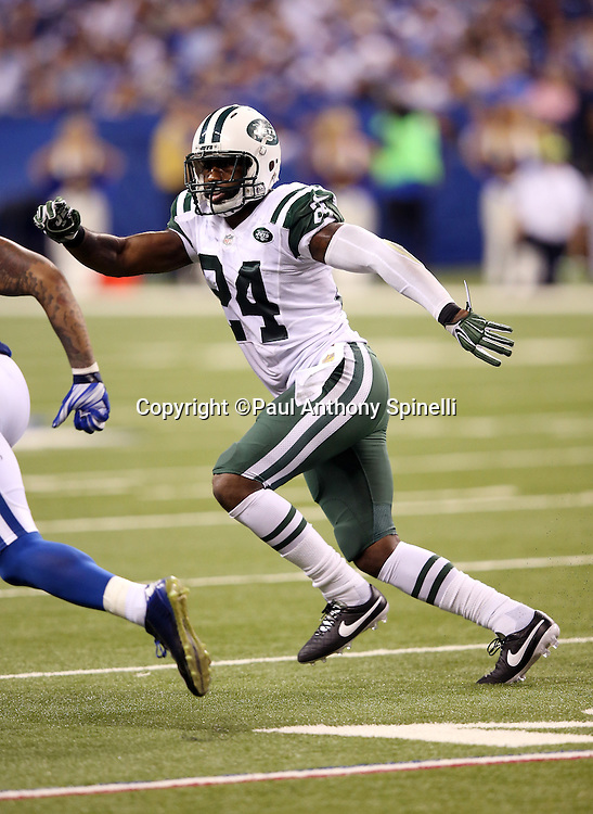 New York Jets cornerback Darrelle Revis (24) chases the action during the 2015 NFL week 2 regular season football game against the Indianapolis Colts on Monday, Sept. 21, 2015 in Indianapolis. The Jets won the game 20-7. (©Paul Anthony Spinelli)