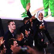 Opening Ceremony 2016 Ibtihaj Muhammad, USA, waves to the crowd as athletes enter Maracana Stadium during the spectacular opening ceremony for the 2016 Olympic Games on August 5, 2016 in Rio de Janeiro, Brazil. (Photo by Tim Clayton/Corbis via Getty Images)