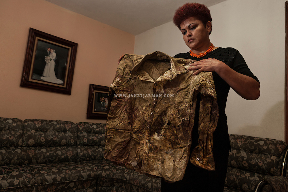 Against a backdrop of photos from her wedding, Fanny Carranza Domínguez displays the bloodied clothing that her husband, Gonzalo Domínguez Díaz, was wearing when unidentified gunmen assassinated him in May 2006. Domínguez was among more than 100 law enforcement officials gunned down or tortured to death in Mexico that year. Much of the violence has been attributed to intensified turf wars between drug gangs who have used increasingly brutal methods to drive home their threatening messages, including dozens of beheadings.