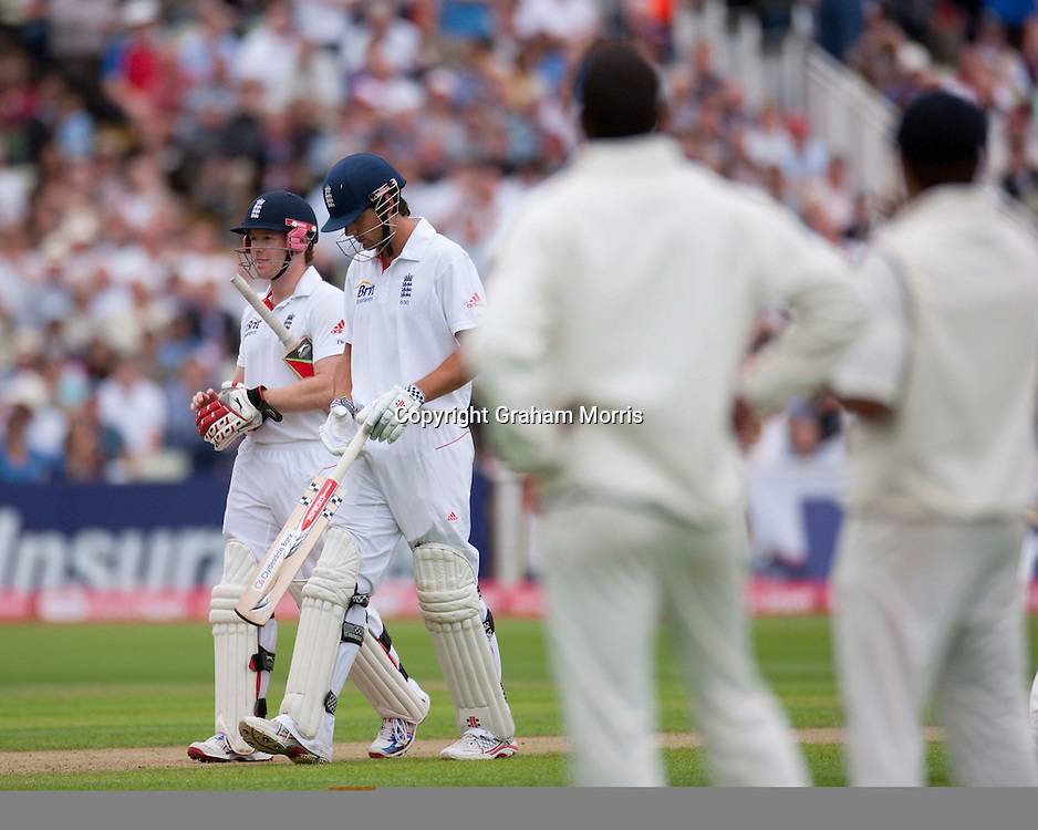 Eoin Morgan (left) and Alastair Cook walk off as a power cut stops play during the third npower Test Match between England and India at Edgbaston, Birmingham.  Photo: Graham Morris (Tel: +44(0)20 8969 4192 Email: sales@cricketpix.com) 12/08/11