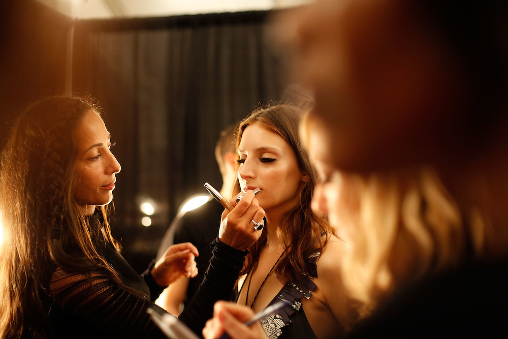 NEW YORK - SEPTEMBER 12:  A model getting ready backstage at the Vivienne Tam Spring 2010 during Mercedes-Benz Fashion Week at Bryant Park on September 12, 2009 in New York City.  (Photo by Joe Kohen/WireImage)