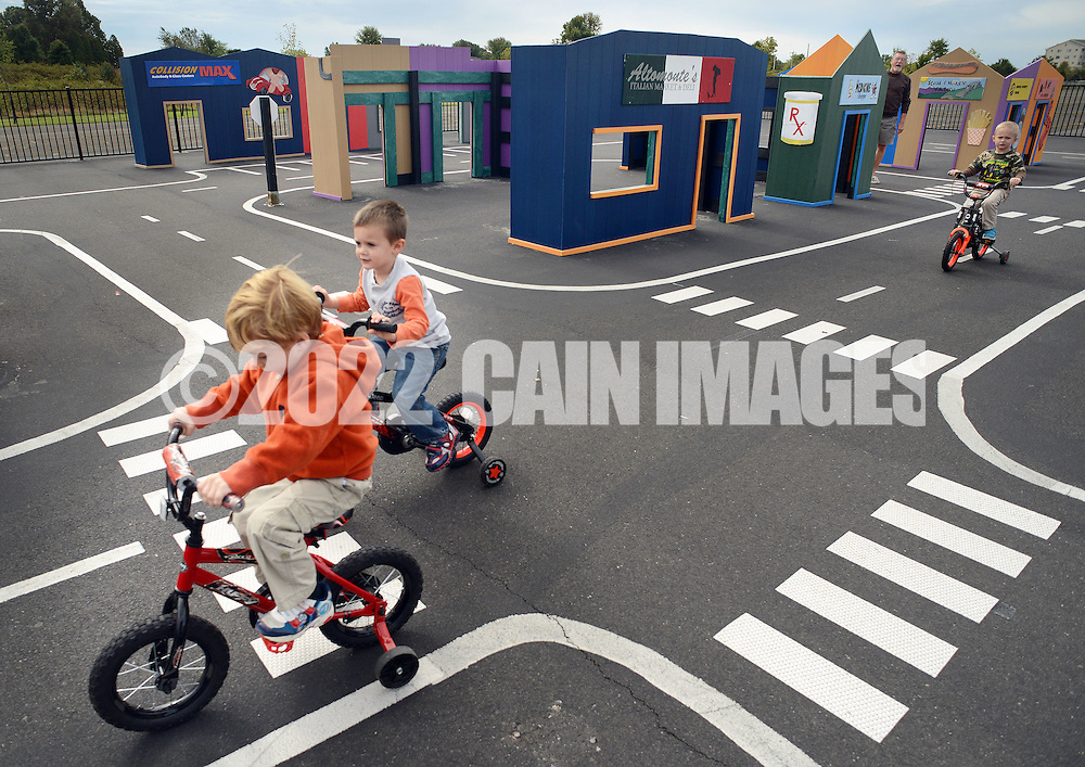 WARMINSTER, PA - OCTOBER 7: From left, Dominic Alessi, 3, Patrick McCarty, 4, and Hunter Becker, 4, all of Warminster, Pennsylvania ride bicycles at Safety Town at Warminster Community Park October 7, 2014 in Warminster, Pennsylvania. Safety Town is a miniaturized version of Warminster Township where young children can ride bikes and play in a make-believe town. The safety signs and street markings have been shrunk down to smaller size to help teach the importance of street safety.  (Photo by William Thomas Cain/Cain Images)