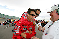 Sam Hornish Jr. and Helio Castroneves have a little fun at the Pikes Peak International Raceway, Honda Indy 225, August 21, 2005