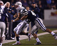 Kansas State linebacker Brandon Archer (46) hits Florida Atlantic quarterback Sean Clayton (15) out of bounds short of the first down in the second half, at Bill Snyder Family Stadium in Manhattan, Kansas, September 9, 2006.  The Wildcats beat the Owls 45-0.
